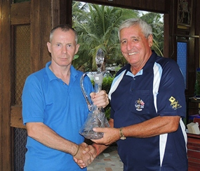 JingJo, the late Frank O'Neill's son, left, presents the newly named trophy to George Bishop.