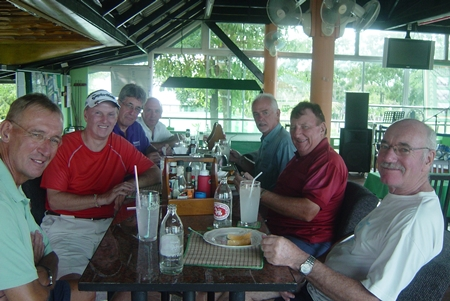 Golfers enjoy some post game camaraderie at Mulligans Lakeside.
