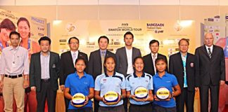 City officials, tournament organizers and sponsors pose for a photo at a press conference held to announce the 23–28 October Beach Volleyball championship.