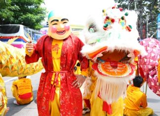 'Pae Yim', aka 'Sim Hua Roa' or the Laughing Aunty, poses with her lion during the festivities.