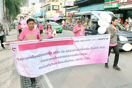 Marchers from sponsors Central Festival Pattaya Beach campaign to raise awareness of breast cancer.