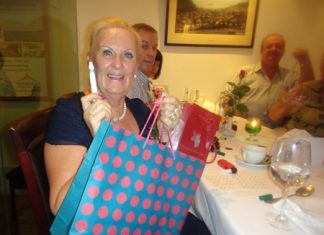Brenda Bradbrooke with her prize and her lucky pen.