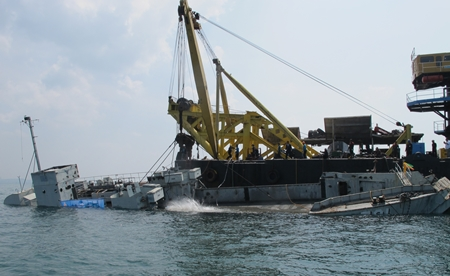 Down she goes!  HTMS Mataphon begins its new mission as an underwater diving site near Koh Larn.