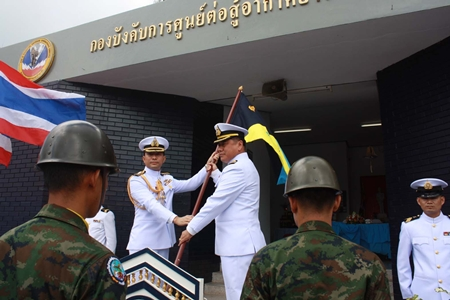 Outgoing commander, Capt. Buan Mattawanukul (left) hands over the leadership flag to Capt. Somprasong Wisoldilokpanth.
