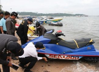 Officials inspect and take photos of jet skis along Pattaya Beach in an attempt to end the national embarrassment of jet ski scams.