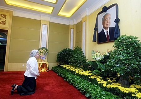 Cambodian Queen Mother Norodom Monineath Sihanouk mourns for her husband and former King Norodom Sihanouk in Beijing, China, on Monday, Oct. 15, 2012. Sihanouk, the revered former king who was a towering figure in Cambodian politics through a half-century of war, genocide and upheaval, died Monday. He was 89. He had been getting medical treatment in China since January and had suffered a variety of illnesses, including colon cancer, diabetes and hypertension. (AP Photo/Xinhua, Lan Hongguang)