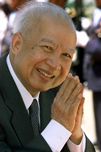 In this July 17, 2001 file photo, Cambodia's King Norodom Sihanouk acknowledges the crowd while walking to greet North Korea's national assembly leader Kim Yong Nam at Phnom Penh airport, in Cambodia. (AP Photo/Andy Eames, File)