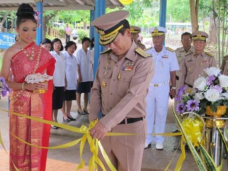 Royal Thai Navy Vice Adm. Chainarong Charoenrak cuts the ribbon opening Sattahip School's new library building.
