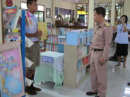 Vice Adm. Chainarong Charoenrak is given a tour of the new library.