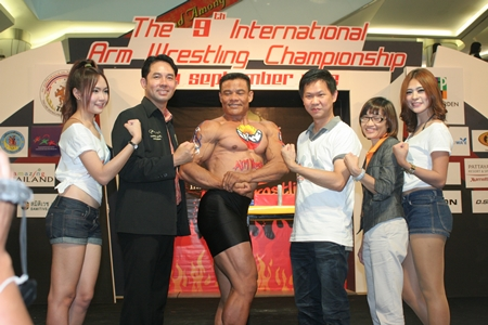 Somporn Naksuetrong, 3rd right, manager of Royal garden Plaza Pattaya; Passalin Saewarat, assistant director of TAT Pattaya office, 2nd right; and city mayor Ittipol Kunplome, 2nd left, officially launch the 9th Pattaya International Arm Wrestling Championship.