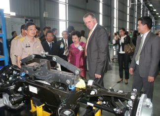 Reinhard Buhl (center right), CEO of ZF Lemforder (Thailand) Co. takes Industry Ministry Deputy Permanent Secretary Attchaka Seebunruang (center left) and officials on a tour of the plant.