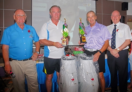 Derek Brook (left) and Graham Macdonald (right) with the winners of this year's Poppy Golf.