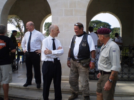 The British Ambassador Mark Kent greets some of the bikers.