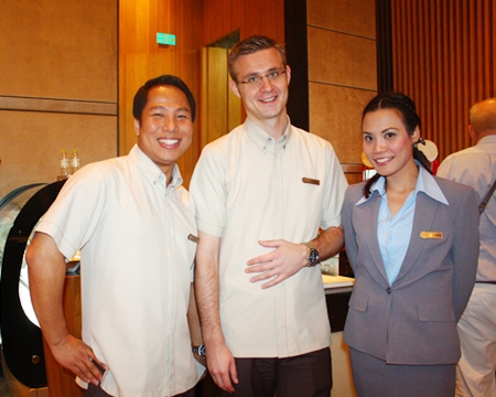 (L to R) Sunday, Simon and Aum help ensure the success of the Christmas Bazaar at the Hilton Hotel, Pattaya.