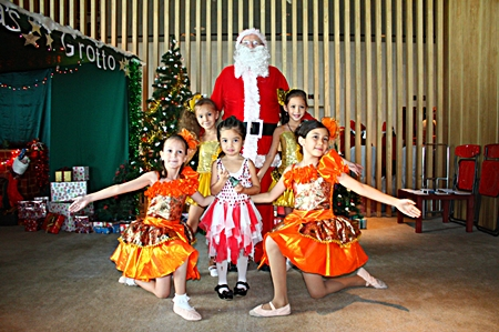 Santa surrounded by little dancers.