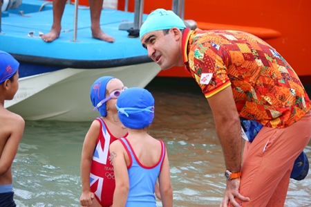 Mark Lunev gives last minute pointers to his daughter before the Fun Swim Competition.