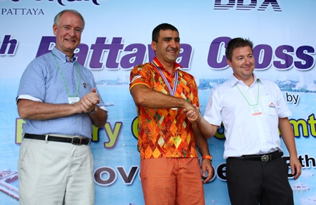 Ronny Heltne (right) congratulates Mark Lunev (middle), winner of the 1.2 km male category, as President Dieter Reigber applauds.