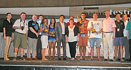Winners and sponsors gather on stage for the 9th Rotary Pattaya Cross Bay Charity Swim award presentation and closing ceremony.
