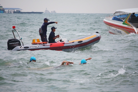 Sea rescue officers closely monitor the safety of the swimmers.
