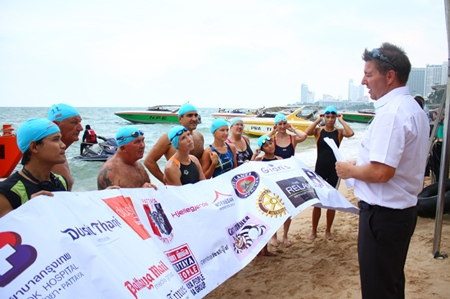 Ronny Heltne (right) explains the rules to swimmers of the 1.2 km race from in front of the Hard Rock Hotel.