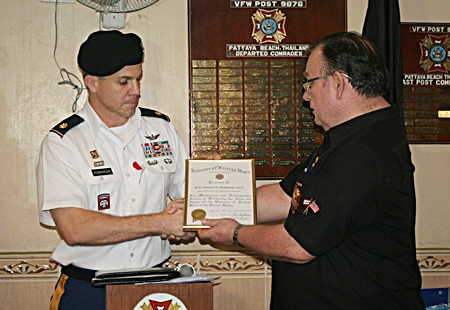 Commander Eric Larsen presents Major Daniel Robinson with a certificate of appreciation.
