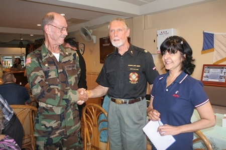Jim congratulates Chaplain Michael Warner as Sue from PMTV looks on.