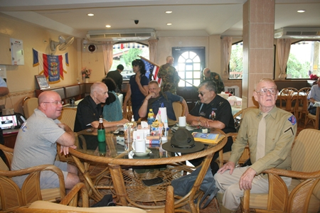 Members enjoy coffee and beer among family and comrades.