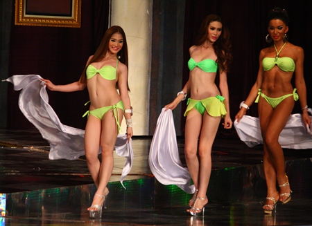 Miss International Queen 2012 Kevin Balot (left) leads a procession of bikini clad contestants during the swimsuit competition.