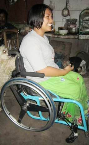 Even in the relative dark of night, that great smile of Jaruwan's lights up the room in her refurbished wheelchair.