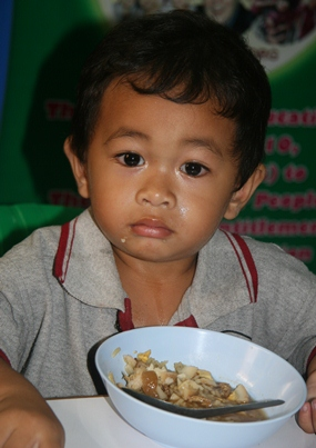 Help feed this little tyke and his friends by buying and donating a bag of rice during this year's SOS Rice Appeal.