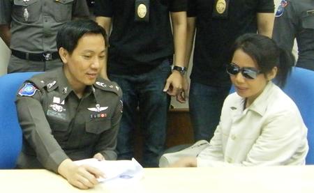 Jidapa Mul-udd (right) was caught at the Cambodian border in Chantaburi.