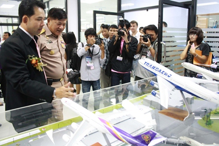 Mayor Itthiphol Kunplome checks out the artist's model of the new passenger terminal for U-Tapao-Pattaya International Airport.
