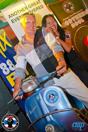 "Johnny Diamond and Noy ""ride the Vespa""."