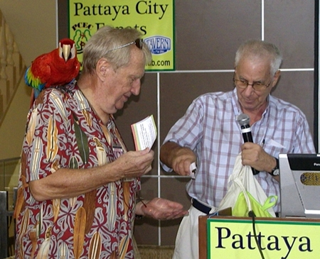 Following John's talk, MC Richard Silverberg helps 'Hawaii Bob' Sutterfield with the Frugal Freddy lucky draw.