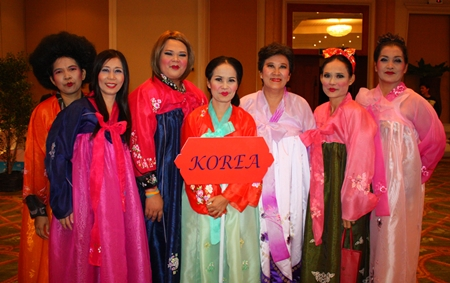 The pink team dons Korean national dresses for the contest.