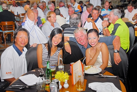 Golfers and partners enjoy the post-golf dinner buffet at Tavern by the Sea.