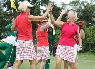 Ladies in Red celebrate a par.