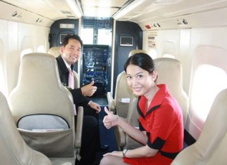 Mayor Itthiphol Kunplome checks out inside of the new Dornier 228.