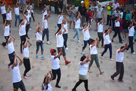 Hilton employees perform a mass dance demonstration outside Central Festival Pattaya Beach.