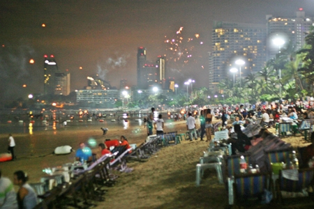 This scene from Loy Krathong last week is typical along Pattaya Beach on all major holidays - smoke fills the air from unregistered fireworks being shot off, up and down the beach, with the area sometimes resembling a war zone.