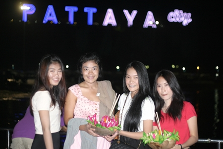Lovely lasses create a picture perfect postcard of their Loy Krathong experience at Bali Hai in South Pattaya.