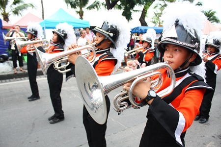 The school marching band keeps the rhythm for the marchers in the parade.