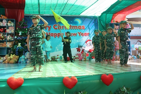 'Thaharn Kenth Ro Rak' (soldier waiting for love) is performed by Kindergarten 3 children from the Fountain of Life Center.