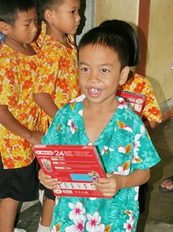 The children were truly excited after receiving coloring sets from the Eglis family.