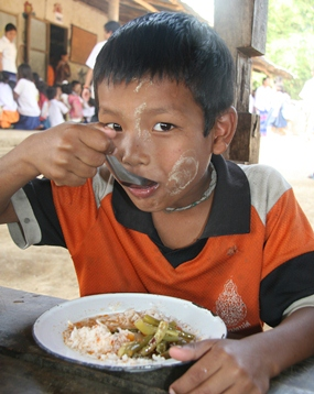 Just one of the thousands of children in Mae Sot who receive a nutritious school lunch each day.