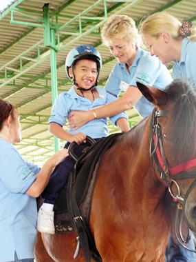 The riders may overcome fears, learn trust and interact socially with their helpers.