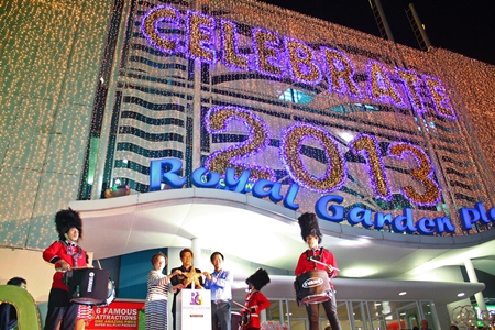 (L to R) Parida Vimolpand, general manager of the Royal Garden Plaza; Banjong Banthoonprayuk, member of the Pattaya city council; and Somporn Naksuetrong, vice president of Royal Garden Plaza & Entertainment, switch on the thousands of lights decorating the front of Royal Garden Plaza.