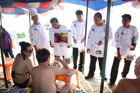 Chefs solicit donations through selling macaroons to tourists on Pattaya Beach.