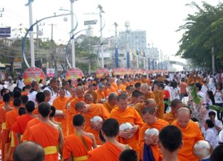 North Pattaya Road from the Samsai intersection to the Dolphin Roundabout is awash with saffron robed monks receiving alms from white clad Buddhists in the annual event to provide relief to 323 embattled Buddhist temples in Thailand's violence-torn south.