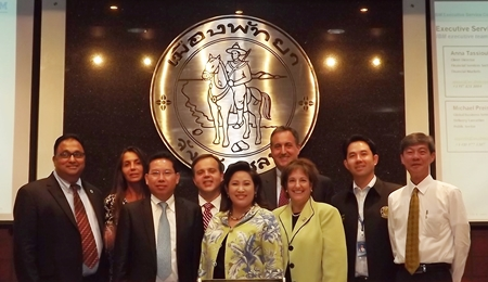 IBM executives pose at City Hall after presenting their ideas about building a public security system for tourists, improving traffic in Pattaya and increasing logistics potential at Laem Chabang Port.
